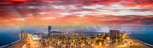Aerial panoramic sunset view of Barcelona oceanfront in Barceloneta, Spain stock photos
