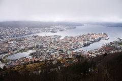 Aerial panoramic top view from hill on city of bergen in cloudy sky, norway Stock Photos