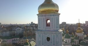 A bird`s eye view, panoramic video from the drone in 4K to the golden dome of the bell tower of Saint Sophia`s Cathedral. Aerial panoramic video from the drone stock video footage