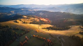 Aerial panoramic view of autumn mountains. Colorful fall royalty free stock image