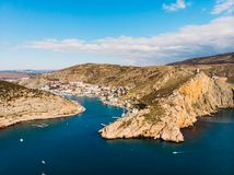 Aerial panoramic view of Balaklava bay in Crimea, mountain cliffs and sea with ships. Beautiful nature panorama landscape. Town among hills and black sea coast stock image