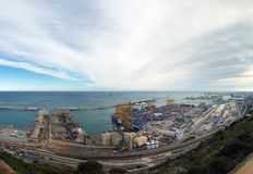 Aerial panoramic view of barcelona docks and harbour with shipping containers being loaded, warehouses grain silos and railway royalty free stock photo