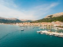 Aerial panoramic view of Baska town, popular touristic destination on island Krk, Croatia, Europe Royalty Free Stock Images