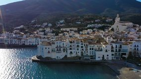 Aerial panoramic view of Cadaques Spain. Curious birds seagulls fly close to the camera. Video footage 4K. Backlight stock video
