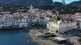 Aerial panoramic view of Cadaques Spain. seagulls fly close to the camera. Video footage 4K. Cozy white city by the see. Popular touristic destination stock footage
