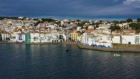 Aerial panoramic view of Cadaques Spain. seagulls fly close to the camera. Video footage 4K. Dali town. Beautiful dramatic sky sunny day stock footage