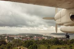 Aerial panoramic view of Cambodian landscape and airplane foreground royalty free stock photo