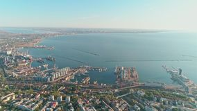 Aerial view from a drone of the city of Odessa and the sea port against a blue sky on a sunny day stock video
