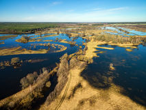 Aerial panoramic view of flooded blue river in spring Royalty Free Stock Images