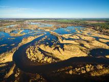 Aerial panoramic view of flooded blue river in spring Stock Photos