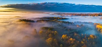 Aerial panoramic view of fog at Autumn, Lithuania royalty free stock photo