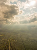 Aerial panoramic view of the forest and clouds. Stock Photos
