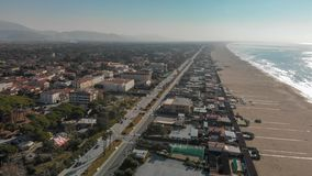 Aerial panoramic view of Forte dei Marmi skyline on a sunny winter morning, drone perspective. Tuscany - Italy royalty free stock photography