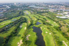 Aerial panoramic view of golf course and houses in city.  royalty free stock images