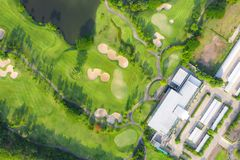 Aerial panoramic view of golf course and houses in city.  royalty free stock photo
