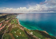 Aerial panoramic view of a golf course next to the cliffs and Bl Royalty Free Stock Photo