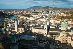 Aerial panoramic view of the historic city of Salzburg with Salzach river in beautiful winter day of sun stock photography