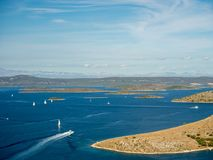 Aerial panoramic view of islands in Croatia with many sailing yachts between, Kornati national park landscape in the Mediterranean Royalty Free Stock Photos