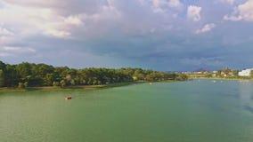 Aerial panoramic view large green water lake against sky stock video