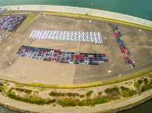 Aerial panoramic view of large parking lot with new imported cars in Port Melbourne, Australia. Aerial panoramic view of large parking lot with new imported royalty free stock images