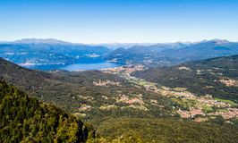 Aerial panoramic view of Luino with lake Maggiore and Swiss mountains. royalty free stock photo