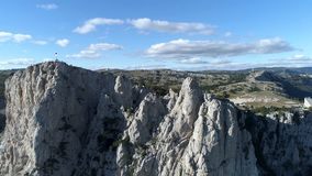 Aerial panoramic view of mountain cableway, above green trees on blue, cloudy sky background. Shot. Fascinating cliffs. Aerial panoramic view of mountain royalty free stock image