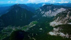 Aerial panoramic view of mountains with pine woods forest. sun flare in summer day in Austria, Obertraun stock video