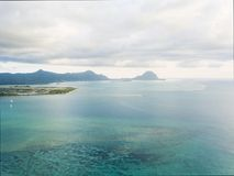 Aerial panoramic view of ocean and mountains Mauritius stock photo