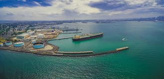 Aerial panoramic view of oil tanker and industrial wharfs. Aerial panoramic view of oil tanker and industrial wharfs near Williamstown suburb in Melbourne Royalty Free Stock Images