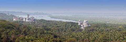Aerial panoramic view Old Goa. Mandovi river and ancient Churches Stock Image