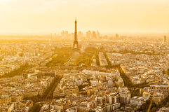 Aerial panoramic view of Paris with the Eiffel tower. At sunset. La Defense district in the background Royalty Free Stock Photography