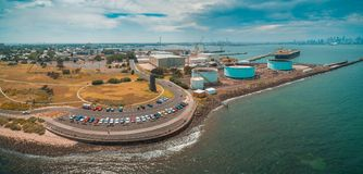 Aerial panoramic view of parking lot and industrial wharfs near ocean coastline at Williamstown suburb of Melbourne, Australia. Aerial panoramic view of parking Royalty Free Stock Photos