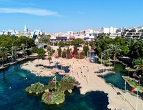 Aerial panoramic view pond, shape of the European continent in the Park of Nations and Torrevieja cityscape. Park dedicated to the nations of Europe. Flags of stock photo