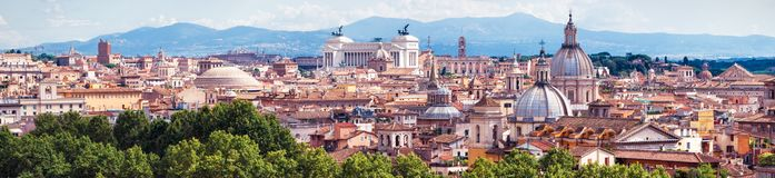 Aerial panoramic view of Rome, Italy. Beautiful Rome skyline in summer. Scenic panorama of Roma city from above. Scenery of historical area of Rome in sunlight stock photo