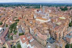 Aerial panoramic view of Siena Cathedral, Duomo di Siena, and Old Town of medieval city of Siena, Tuscany, Italy stock photography