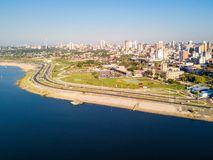 Aerial panoramic view of skyscrapers skyline of Latin American capital Asuncion city, Paraguay. Embankment of Paraguay river. royalty free stock photo