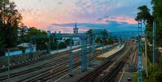 Aerial view of Sochi railway station at sunset. Aerial panoramic view of the Sochi railway station with many railroads and traction line towers at sunset, Russia Royalty Free Stock Photos
