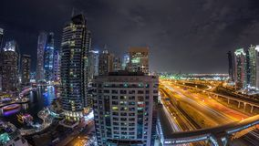 Aerial top view to Sheikh Zayed road near Dubai Marina and JLT timelapse, Dubai. Aerial panoramic view to Dubai Marina skyscrapers and Sheikh Zayed road night stock video footage