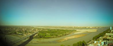 Aerial panoramic view to Khartoum, Omdurman and confluence of the Blue and White Niles, Sudan. Aerial panoramic view to Khartoum, Omdurman and confluence of the Stock Photos