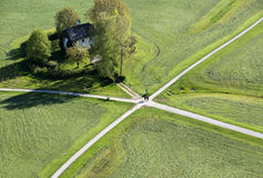 Aerial panoramic view from the top of Hohensalzburg fortress Castle on cultivated land divided by the crossing ways roads. Sal royalty free stock images