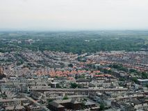 Aerial panoramic view of the town of blackpool looking east showing the streets and roads of the town with lancashire countryside. Stretching to the horizon stock photos