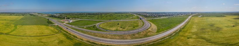Aerial panoramic view of transportation highway overpass, ringway, roundabout, urban traffic royalty free stock photography