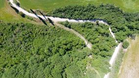 Aerial panoramic view of Tuscany winding road, Italy.  stock photos