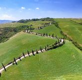 Aerial panoramic view of Tuscany winding road, Italy.  royalty free stock photos