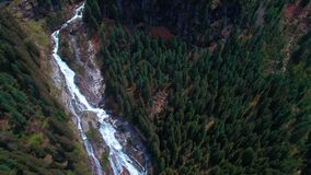 Aerial panoramic view of a waterfall on the pine forests in the mountains of Austria. Aerial panoramic view of a waterfall on the pine forests in the mountains stock footage