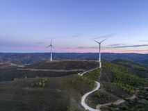 Aerial panoramic Wind farm turbines silhouette at sunset. Clean renewable energy power generating windmills. Algarve countryside. Portugal Stock Photo