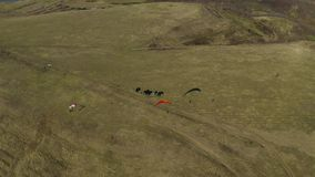Aerial of paraglider stock footage