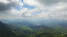 Aerial Paragliding over Mountains and Valleys stock video footage