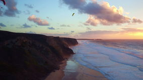Aerial from parasailing at Vale Figueiras in Portugal. At sunset stock footage