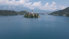 AERIAL: Past the trees towards the church of Bled stock video